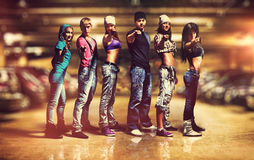 Dancer team. Six people modern dancers team. Showing pointing hand sign. Underground car parking interior Stock Images