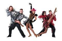Dancer team wearing carnival costumes dancing Royalty Free Stock Image
