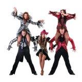 Dancer team wearing carnival costumes dancing Stock Photo