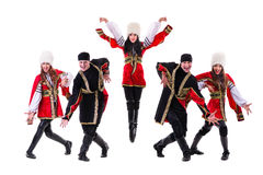 Dancer team wearing a folk Caucasian highlander costumes. Dancing. Isolated on white background in full length Stock Photos
