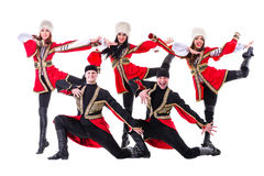 Dancer team wearing a folk Caucasian highlander costumes. Dancing. Isolated on white background in full length Royalty Free Stock Photography