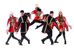 Dancer team wearing a folk Caucasian highlander costumes. Dancing. Isolated on white background in full length Royalty Free Stock Photos
