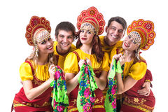 Dancer team wearing a folk costumes isolated on Stock Images