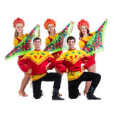 Dancer team wearing a folk costumes isolated on. Dancer team wearing a folk costumes dancing.  Isolated on white background in full length Royalty Free Stock Photo