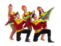 Dancer team wearing a folk costumes isolated on Royalty Free Stock Photos
