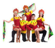 Dancer team wearing a folk costumes isolated on Stock Photo