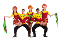 Dancer team wearing a folk costumes isolated on. Dancer team wearing a folk costumes dancing.  Isolated on white background in full length Royalty Free Stock Photos