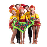 Dancer team wearing a folk costumes isolated on. Dancer team wearing a folk costumes dancing.  Isolated on white background in full length Royalty Free Stock Image