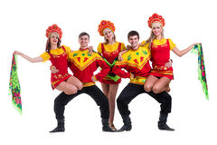 Dancer team wearing a folk costumes isolated on Royalty Free Stock Images