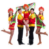 Dancer team wearing a folk costumes isolated on Stock Photography