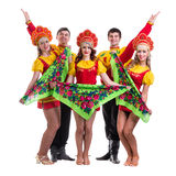 Dancer team wearing a folk costumes isolated on Stock Image