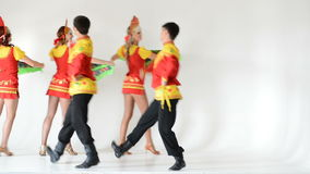 Dancer team wearing a folk costumes isolated on white stock video footage