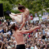 Dancer throwing his partner high in the air. Royalty Free Stock Photography