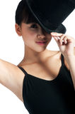 Dancer with Top Hat. A young asian dancer poses with a top hat against white background Stock Images