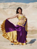 Dancer in violaceous dress Royalty Free Stock Photo