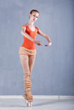 Dancer warming up before rehearsal. Girl stands on tiptoe. Classical Ballet Royalty Free Stock Photo