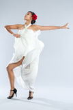 Dancer in white gown and red rose. Stock Photo