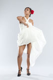 Dancer in white gown and red rose. Stock Images