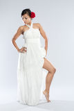 Dancer in white gown and red rose. Royalty Free Stock Photography