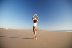 Dancer woman with hat at beach Stock Photography