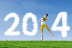 Dancer Woman with 2014 New Year Clouds Royalty Free Stock Photo
