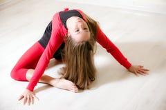 Dancer woman sit on half twine Royalty Free Stock Image