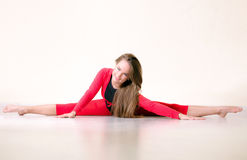 Dancer woman sit on half twine Stock Images