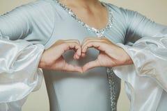 Dancer's hands as a heart shape. Stock Photos