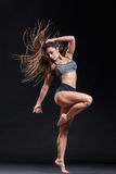 The dancer. Young beautiful dancer jumping in studio stock photos