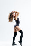 The dancer. Young beautiful dancer jumping on a studio background Royalty Free Stock Photo