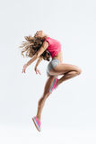 The dancer. Young beautiful dancer jumping on a studio background royalty free stock photos