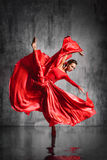 The dancer. Young beautiful dancer posing on studio background royalty free stock photo