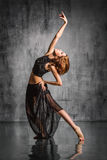 The dancer. Young beautiful dancer posing on studio background stock images