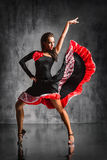 The dancer. Young beautiful dancer posing on studio background Stock Image