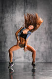 The dancer. Young beautiful dancer posing on studio background royalty free stock image
