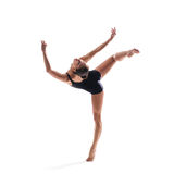 The dancer. Young beautiful dancer posing on studio background stock photography