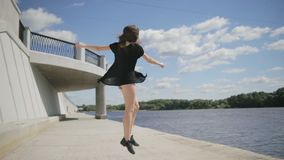 Dancer young woman jumping and spinning around stock video footage