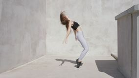 Dancer young woman outdoors shaking head in slow motion stock footage