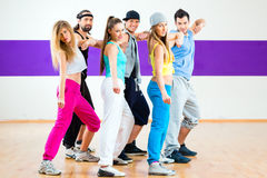 Dancer at Zumba fitness training in dance studio. Young men and women dancing zumba modern group choreography in dance school stock images