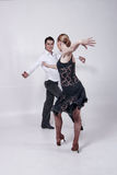 Dancers. Two dancers, man and woman posing and showing some dance figures Stock Photo