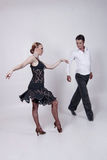 Dancers. Two dancers, man and woman posing and showing some dance figures Stock Image