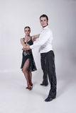 Dancers. Two dancers, man and woman posing and showing some dance figures Royalty Free Stock Photo