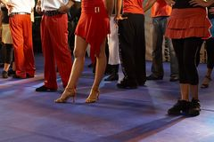 Dancers. Legs of the salsa dancers stock image