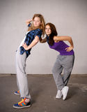 Dancers. Two teenage girls standing against wall Royalty Free Stock Photography