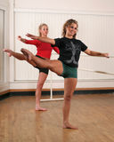 Dancers. Two teen dancers practicing ballet moves in dance studio royalty free stock image