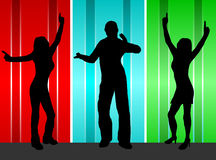Dancers. A group of dancers in silhouette on a stage in front of a red, blue and green satin effect background.  The additional format is saved as a vector in Stock Photos