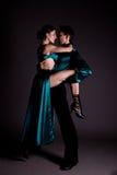 Dancers against black background Stock Images