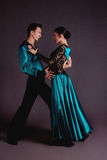 Dancers against black background Royalty Free Stock Image