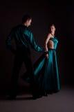 Dancers against black background Stock Photos