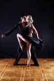 Dancers in ballroom. Against black background Stock Photo